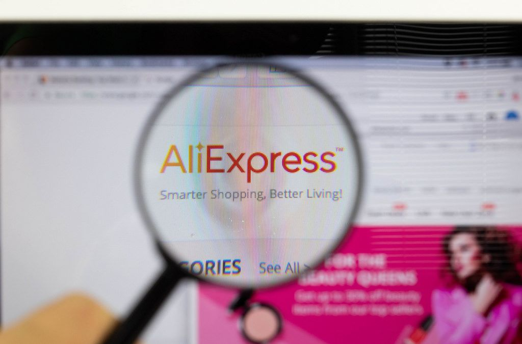 aliexpress logo on a computer screen with a magnifying glass 1